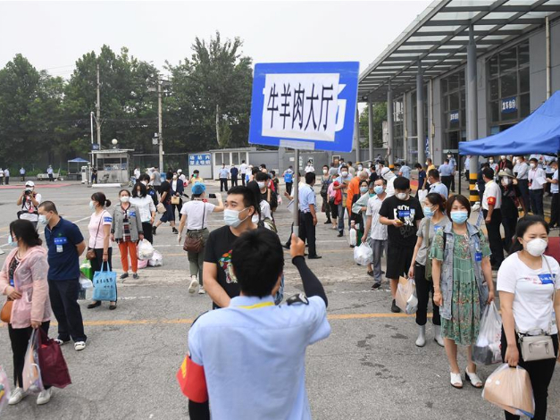 Beijing lowers COVID-19 risk level of one more area