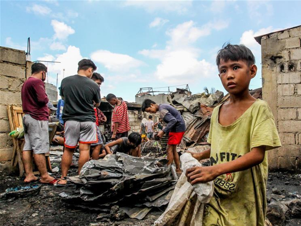 Aftermath of fire at slum area in Manila, the Philippines