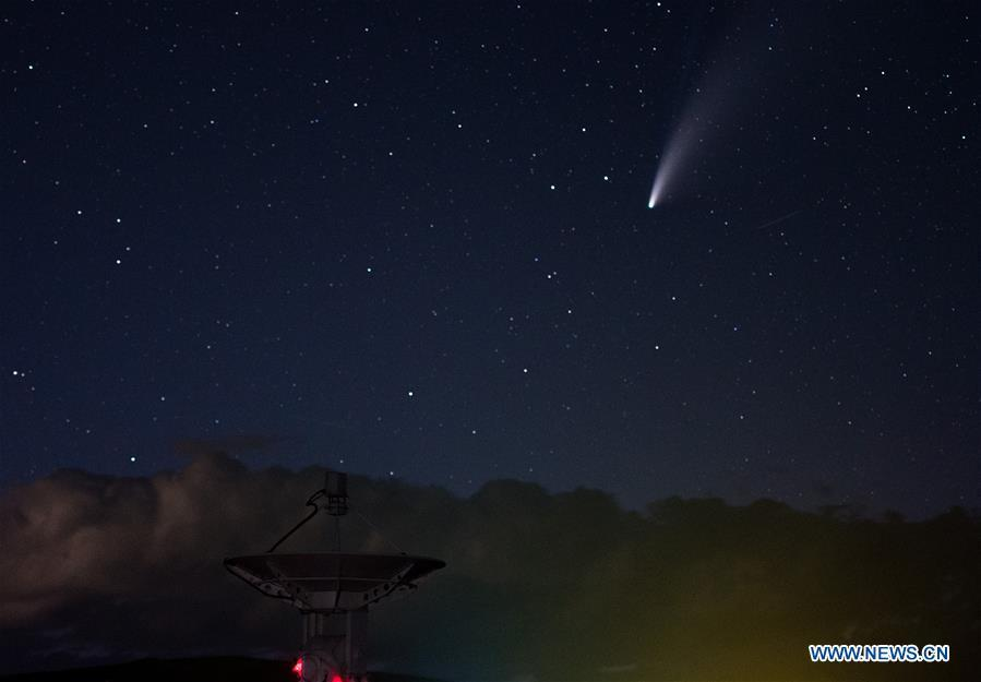 Comet NEOWISE in starry sky over Ming'antu observing station