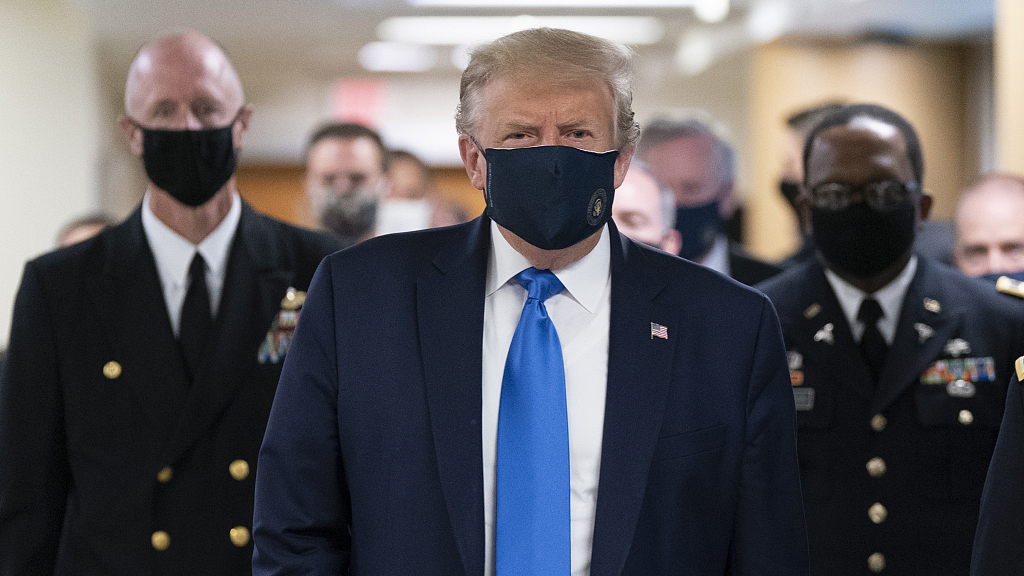 US divided over masks as Trump rejects national mask mandate
