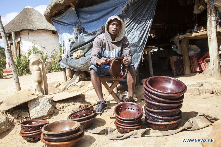 Craftsmen work at Kabwata Cultural Village in Zambia