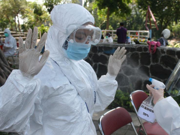 Medical workers collect swab sample for COVID-19 test in Surabaya, Indonesia