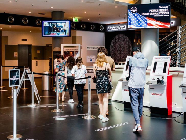 People walk into reopened movie theater in Berlin, Germany
