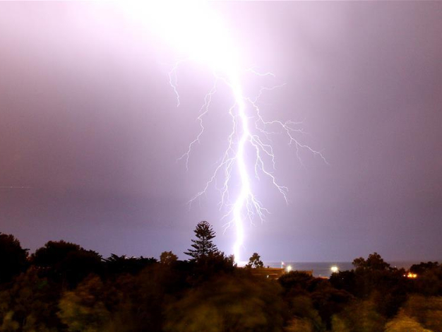 Lightning flashes during thunderstorm over Greater Lisbon in Portugal