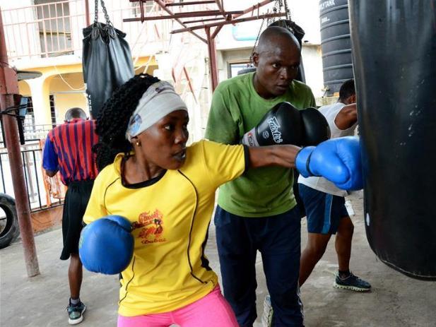 Female boxer trains at boxing club in Dar es Salaam, Tanzania