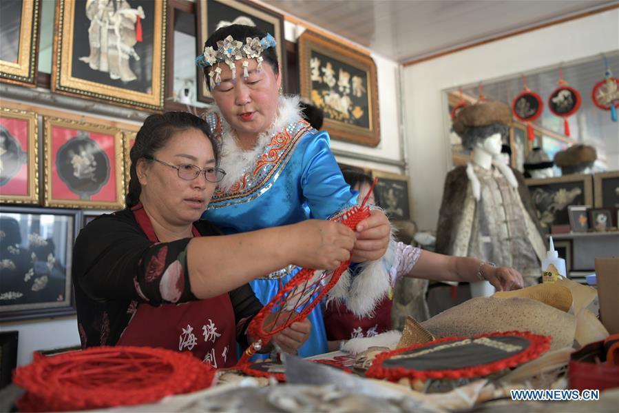 Northeast China's ethnic minority families shake off poverty