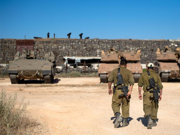 Israeli army says reinforces troops along Lebanese border