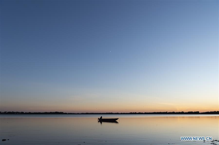 In pics: fishing on Dalijia Lake in NE China