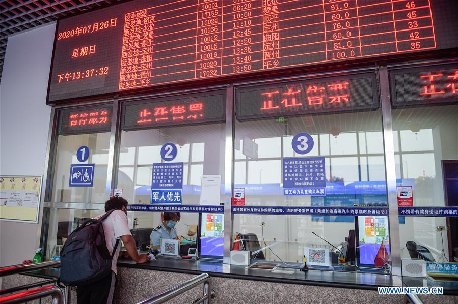 Long-distance bus travel services resume at Beijing's Xinfadi intercity bus terminal