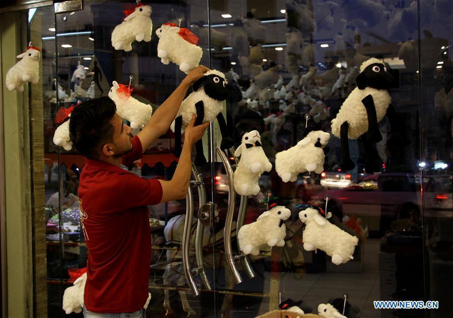Palestinian vendor displays sheep toys in Gaza City