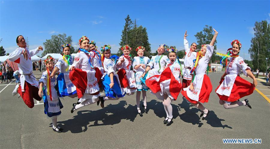 People participate in rural business festival in Belarus