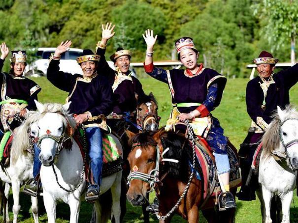 Tourists enjoy leisure time in Lunang Township of Tibet