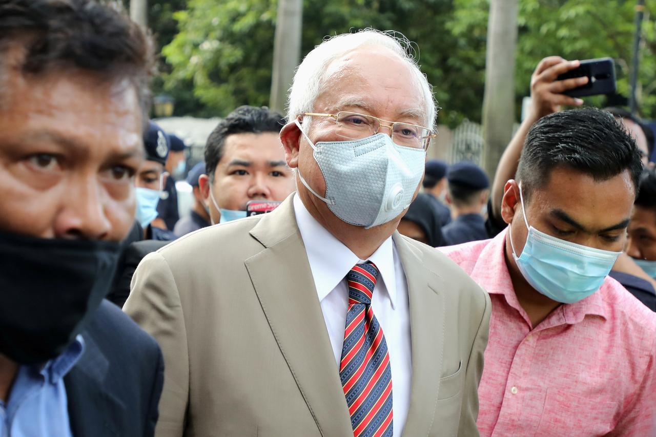 Malaysian ex-PM Najib sentenced to 12 years' jail over 1MDB scandal