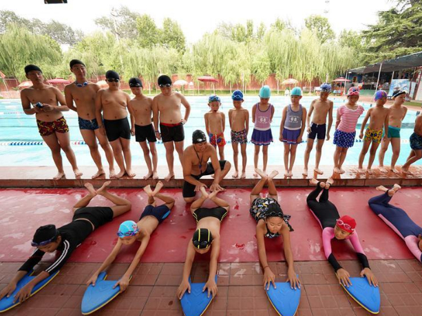 Children learn swimming skills in Shahe, China's Hebei