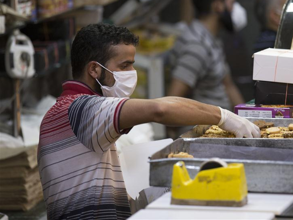 People prepare for Eid Al-Adha festival in Indian-controlled Kashmir