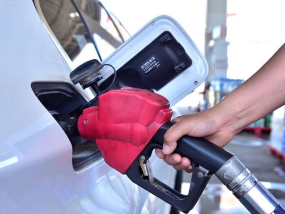 Oil prices edge higher in volatile trading