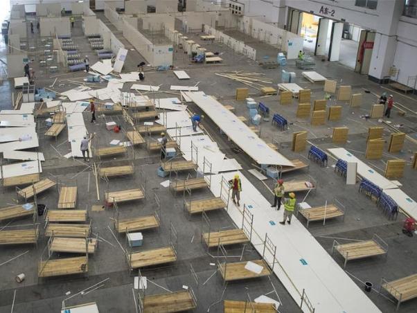 Workers remove hospital facilities at 'Wuhan Livingroom' makeshift hospital