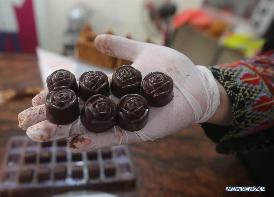 People make homemade sweets ahead of Eid al-Adha festival in Rafah