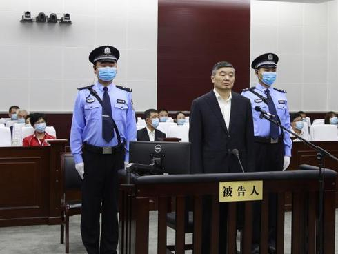 Former bank official stands trial for taking bribes
