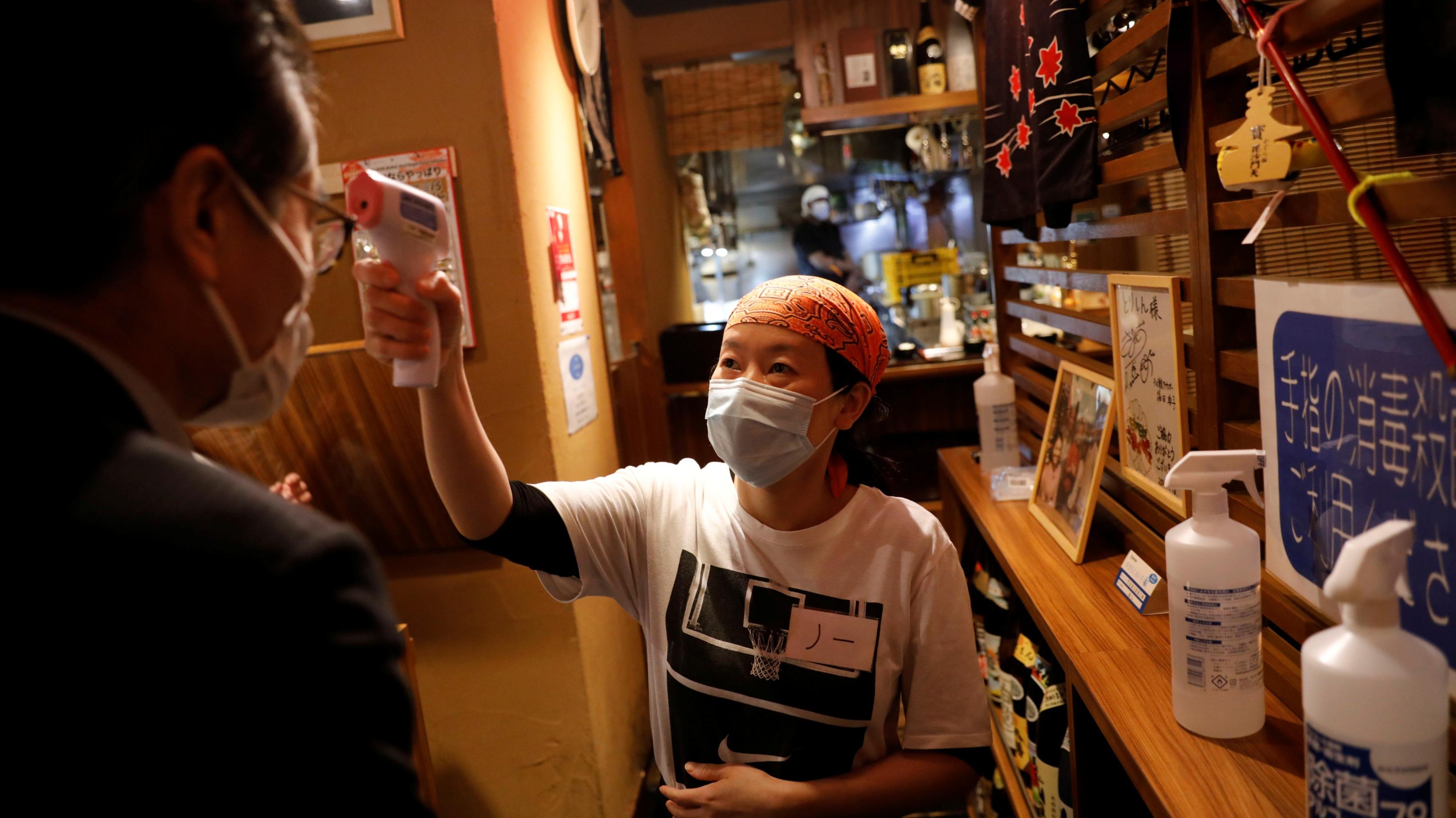 Tokyo asks restaurants, bars to shut early as virus spikes