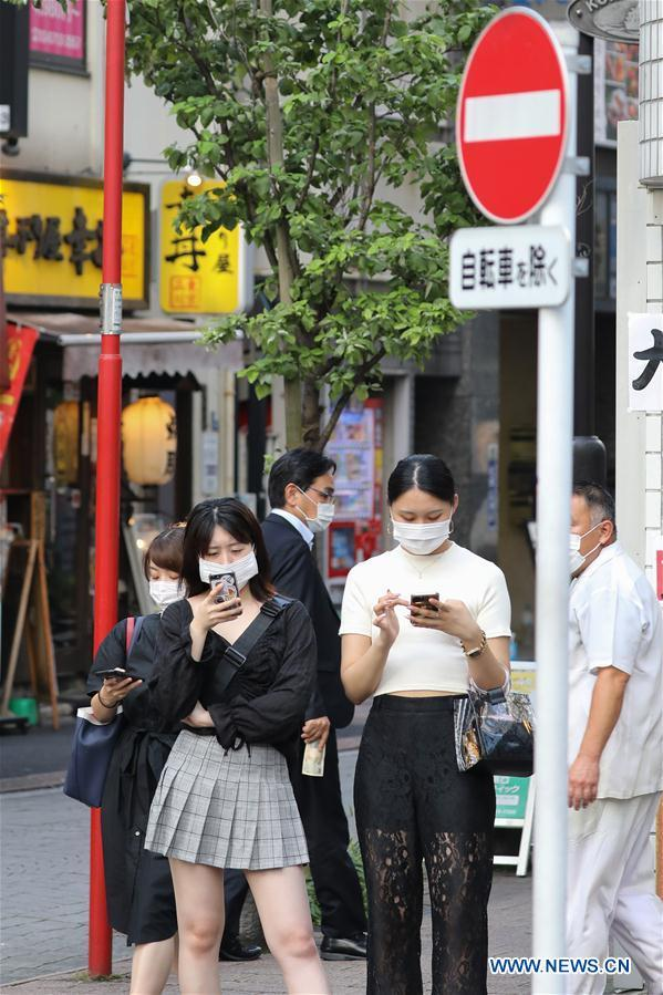 Tokyo confirms record 463 daily COVID-19 cases