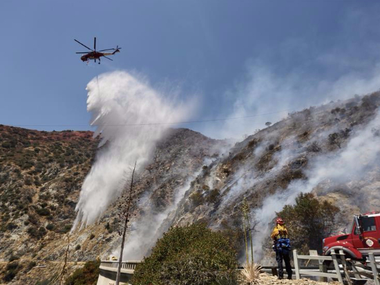 Firefighters participate in battling wildfire at Angeles National Forest