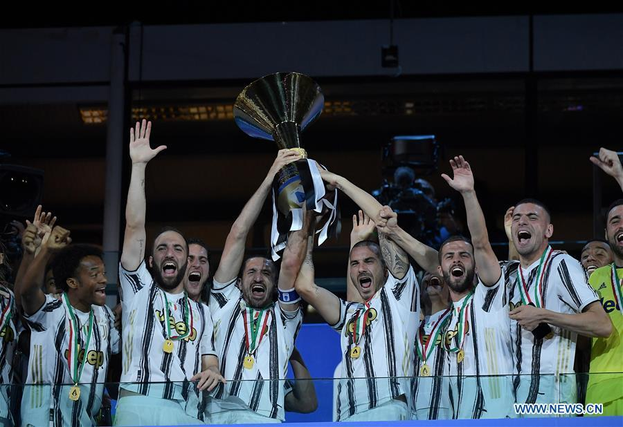 Players of FC Juventus celebrate with trophy at end of Serie A football match