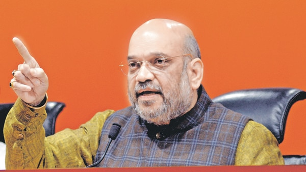 India's home minister tests positive for COVID-19