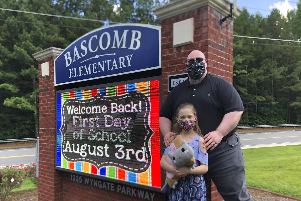 US Parents struggle as schools reopen amid coronavirus surge