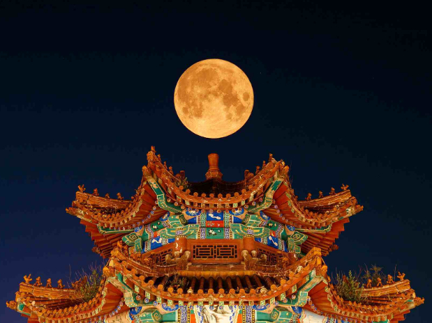 In pics: Rare phenomenon of early full moon seen across China