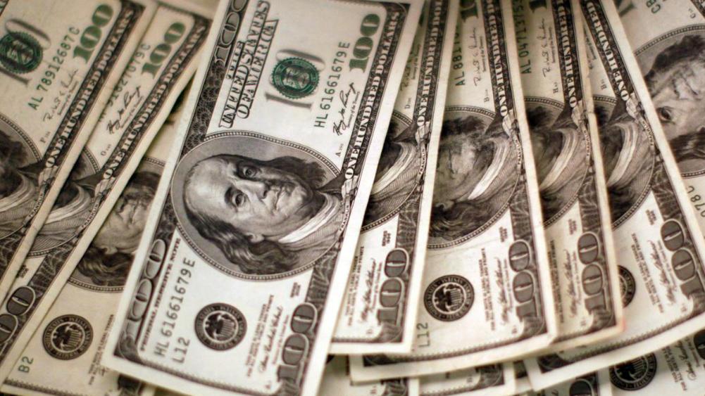 Dollar falters as investors await US stimulus deal