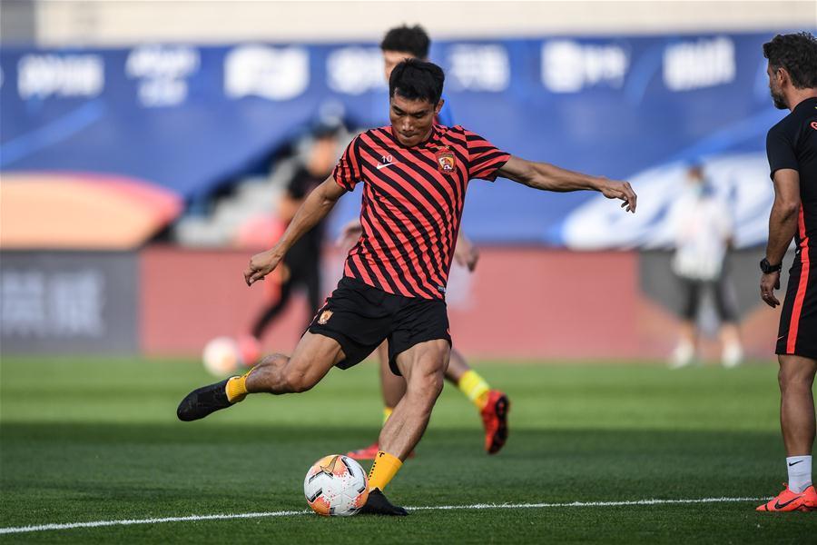 Players warm up prior to match between Guangzhou Evergrande Taobao, Shenzhen Jiazhaoye at CSL Dalian Division