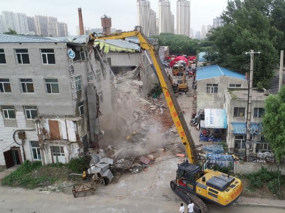 Nine killed in collapsed building in Harbin