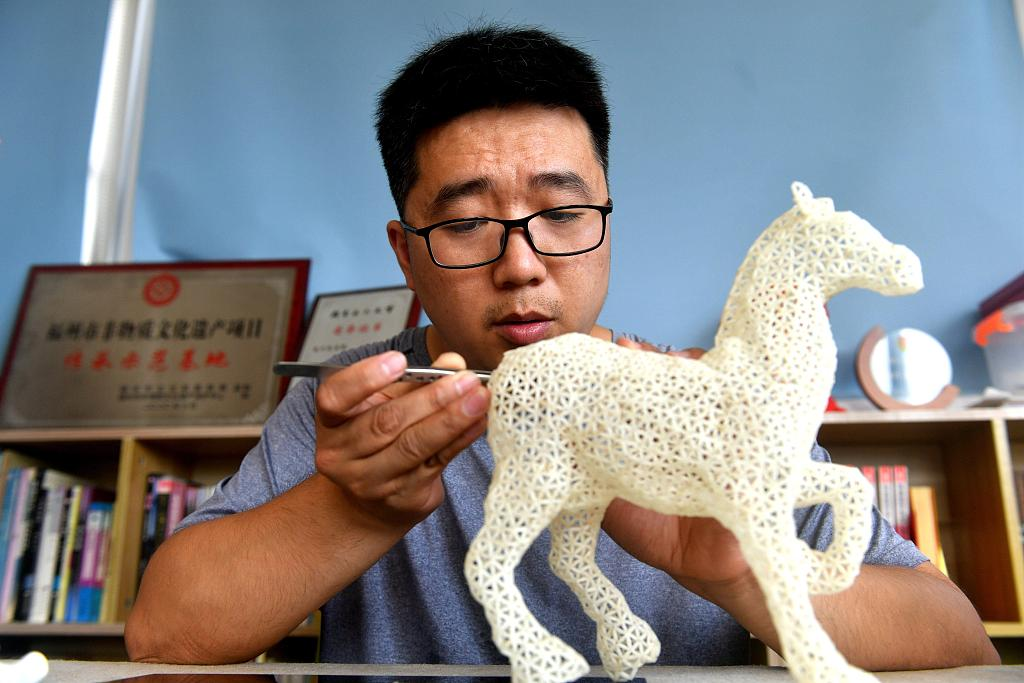 Man revives traditional handicraft made out of rice grains