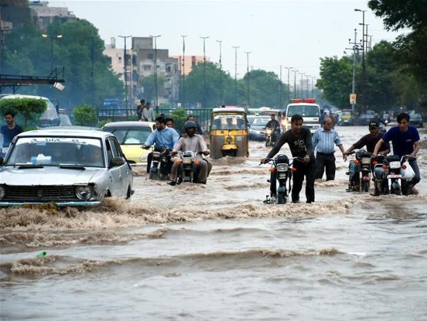 In pics: flooded road after heavy monsoon rain in Karachi, Pakistan