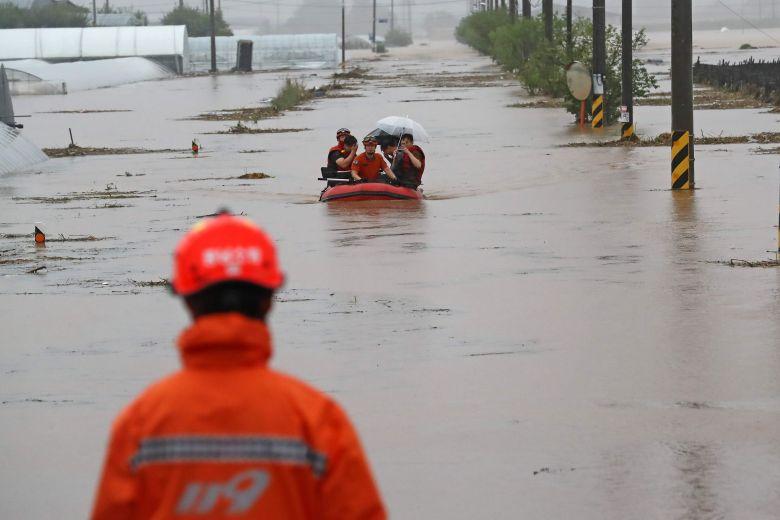 South Korea's floods, landslides kill 21 as heavy rains continue