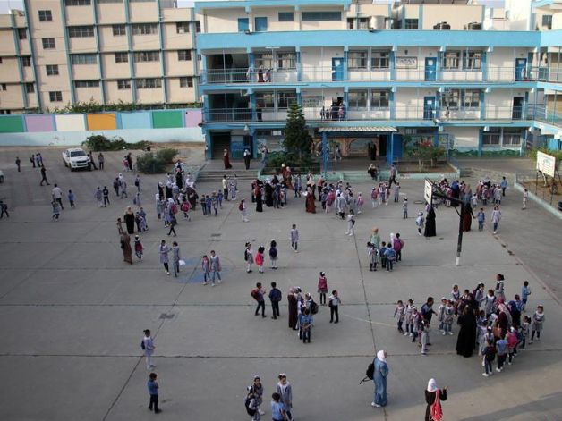 Students attend school on 1st day of new school year at Shati refugee camp in Gaza City