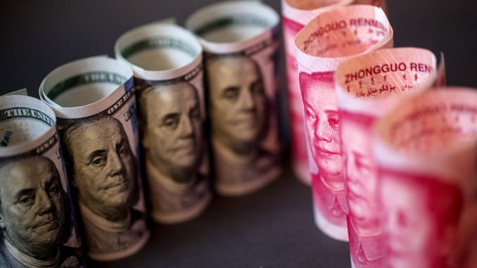 Chinese yuan weakens to 6.9649 against USD Monday