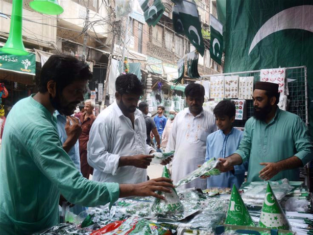 Market decorated with national flags, festive decoratons ahead of Independence Day in Pakistan