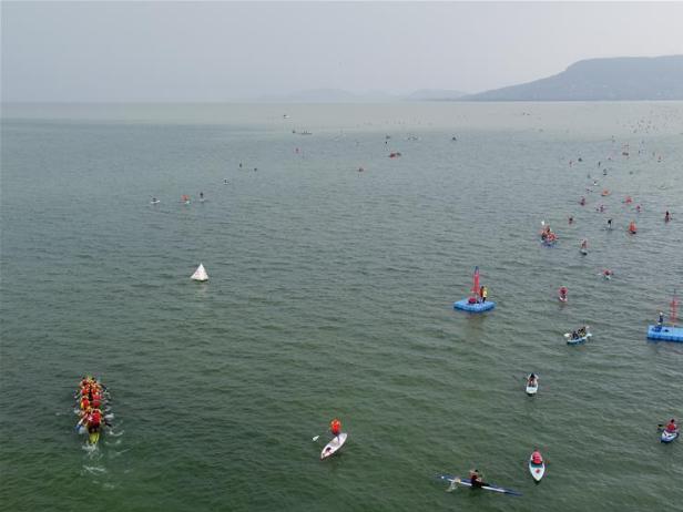 Participants paddle boats across Lake Balaton in Hungary