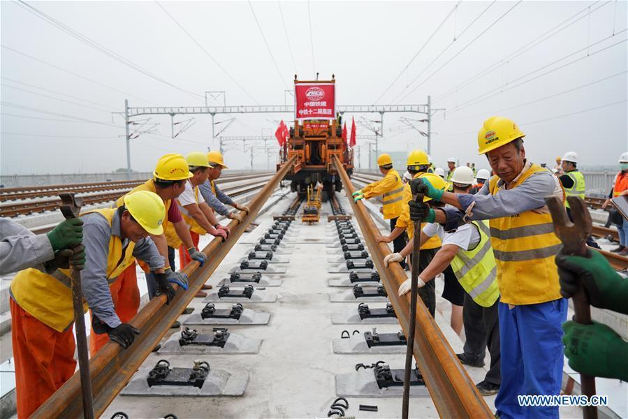 Track-laying of Beijing-Xiong'an intercity railway completed