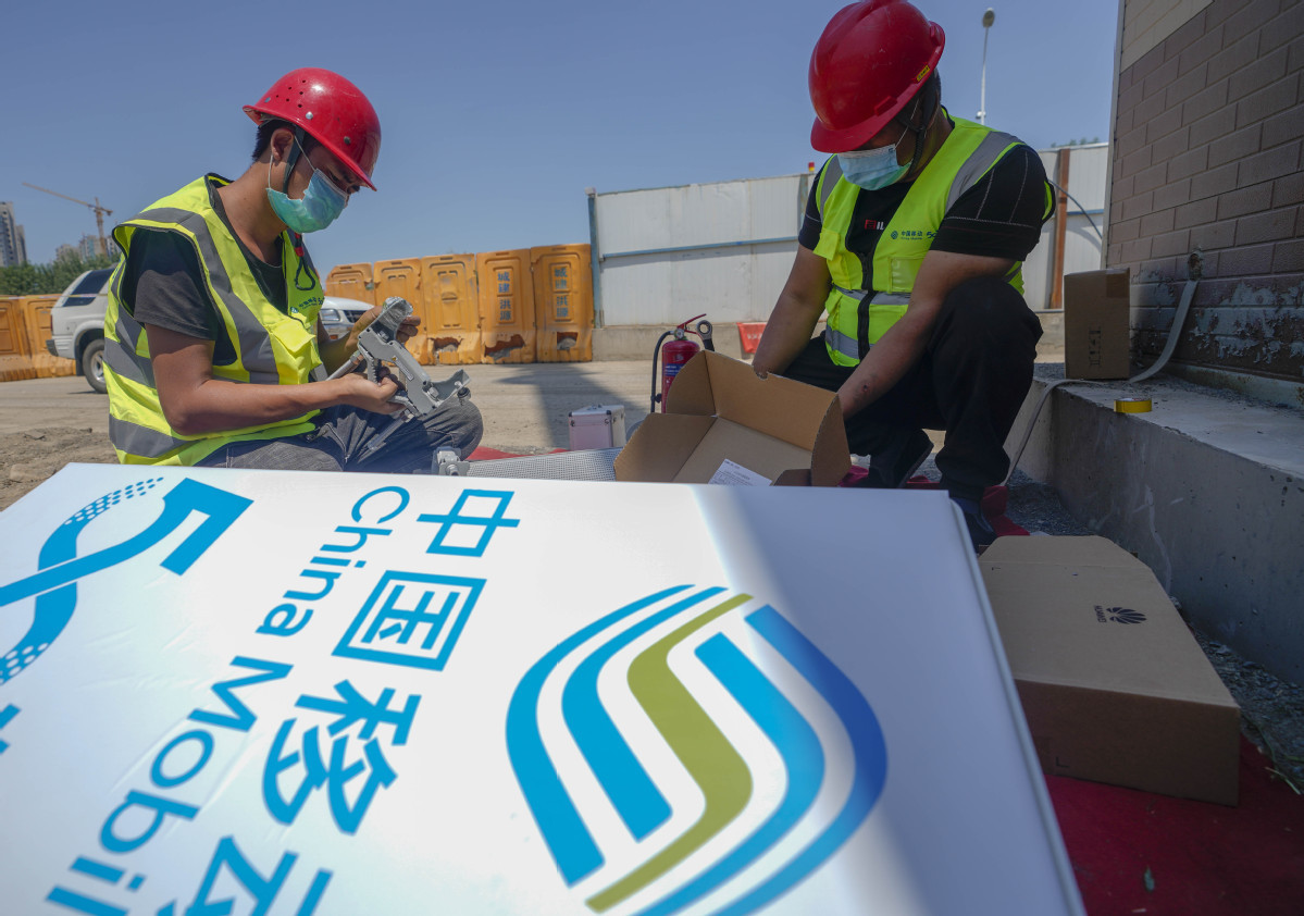 China Mobile reports mild revenue growth in H1
