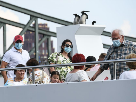 People wear face masks amid COVID-19 outbreak in Frankfurt, Germany
