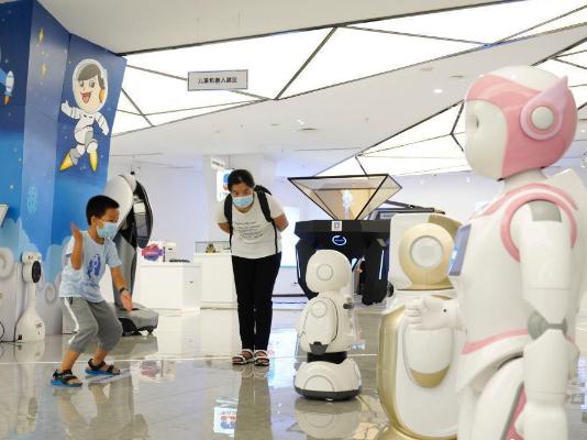 Children visit robot exhibition center during summer vacation in Chongqing
