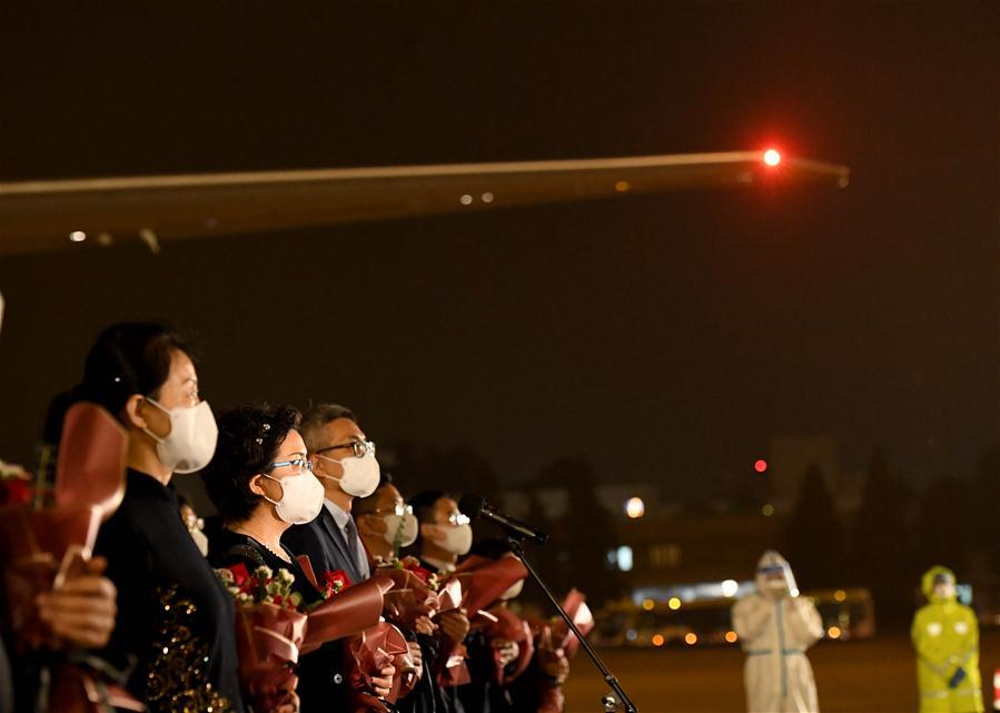 China's consular staff from Houston touch down in Beijing