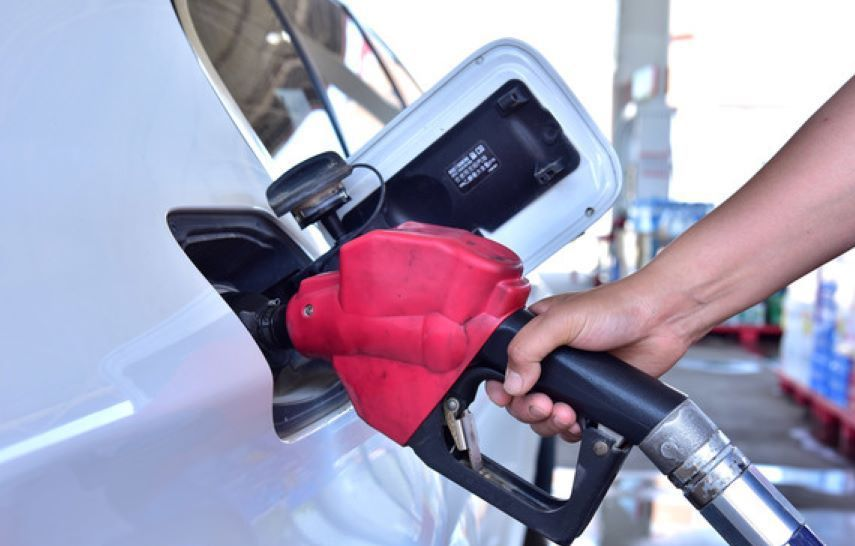 Oil prices rise in volatile trading