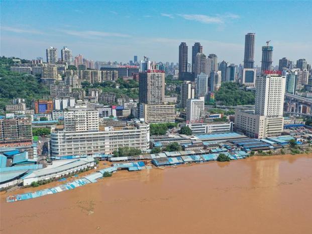 China raises emergency response level to floods