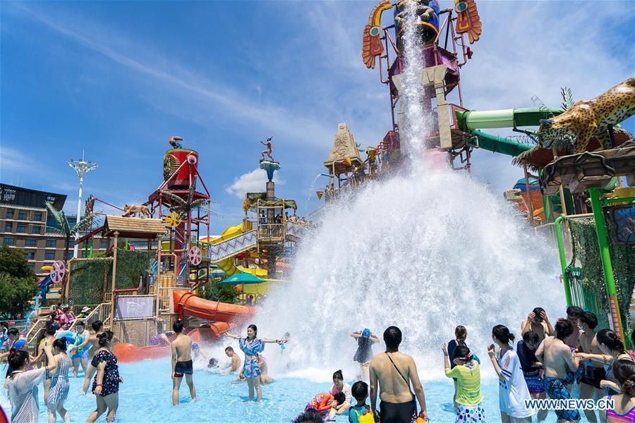 Tourists have fun at Playa Maya Water Park in Wuhan