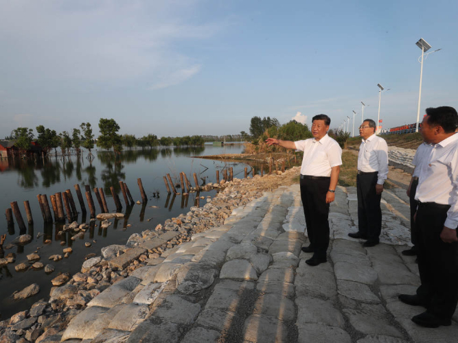 Xi stresses importance of living in harmony with nature