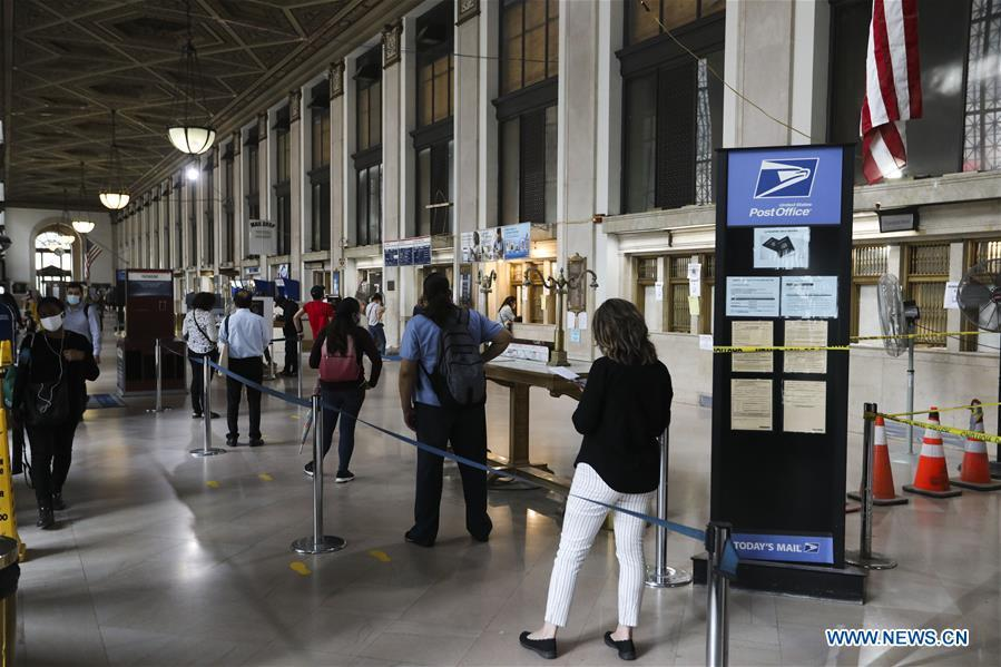 Chief of US Postal Service says to suspend agency reform until after election